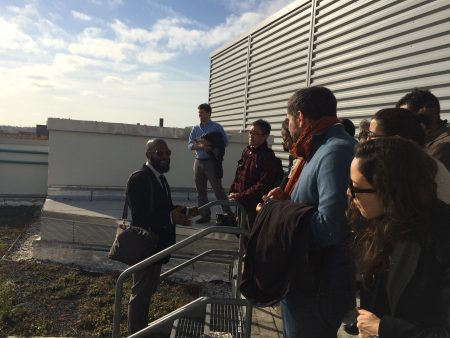 Mark Chamber of DC's Department of General Services shows the CCN around a green roof.